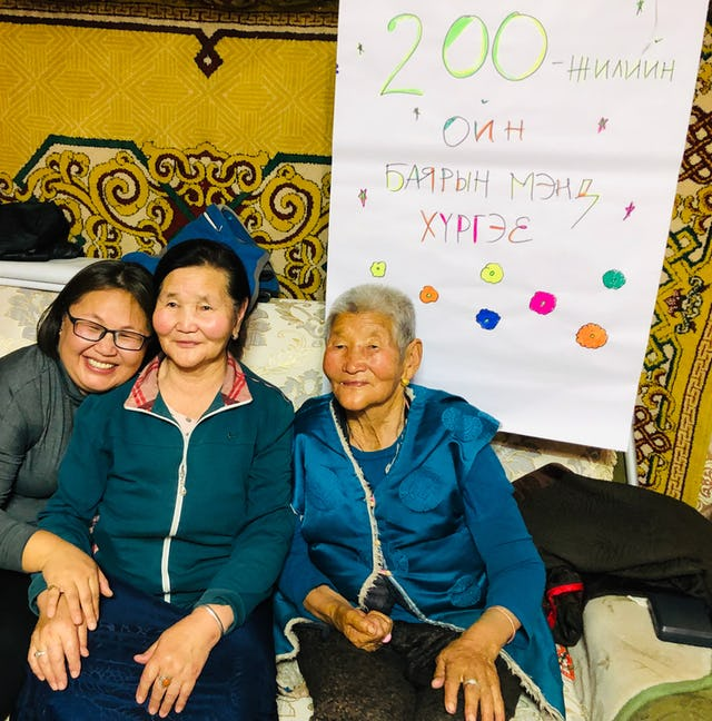 Participants at an extended family celebration in Yesunbulag, Mongolia