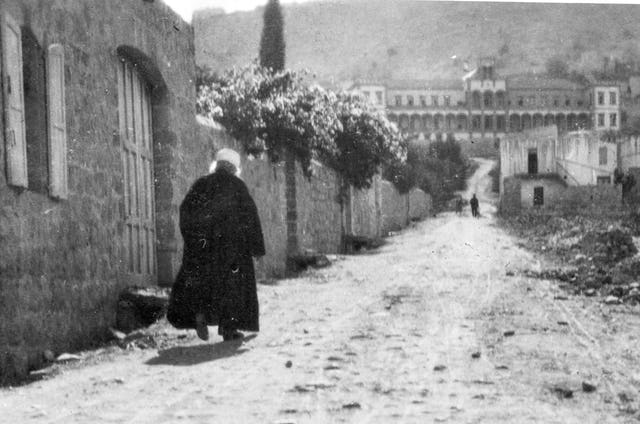 This is an image of 'Abdu'l-Baha, walking outside his home on Haparsim Street in Haifa in 1920, the same year that the First Tablet to The Hague was delivered to the Central Organization for a Durable Peace.