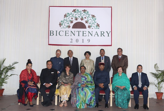 President Ram Nath Kovind and his family are joined in a photo by the members of India's Baha'i National Spiritual Assembly.