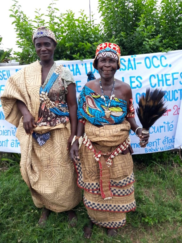 "Chief Nkayi Matala of the Lushiku village (right) and Chief Mbindi Godée of the Ndenga Mongo village at a conference in Kakenge, Central Kasai, held by the Bahá'ís of the DRC. They described the gathering as ""a remarkable step forward that opens up many new possibilities for realizing the unity of peoples and the prosperity of our communities."""