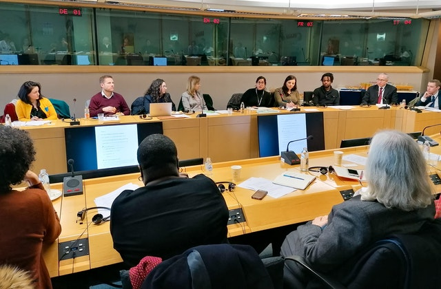 Attendees of the European Parliament panel discussion in which some 40 policymakers and civil society representatives discussed how to transcend differences through unifying language.