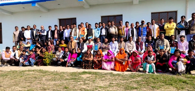 """Village chiefs (pradhans) gathered in Gapchariyapur, Uttar Pradesh, with their families and representatives of the Baha'i community of India. """"Right now in India, people look at differences between religions and make them a cause for division,"""" says Elham Mohajer, """"so we invited some officials to come together and discuss their role in light of a profound reflection on the life of the spirit and the meaning of service."""""""