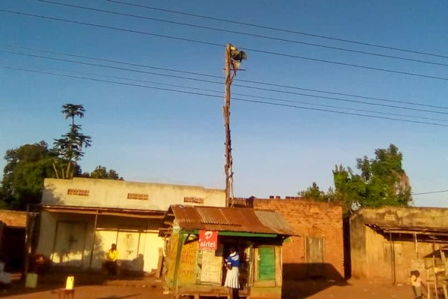 The small studio and mass-communication device in the center of Kiyunga, Uganda. The local leadership made the broadcasting equipment available to the Baha'is and has been supportive of this effort, encouraging villagers to listen, participate in the discussions, and pray in their homes.