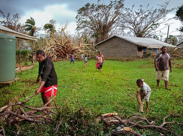 Local community members begin cleanup work at a school after Espiritu Santo, Vanuatu, was struck by Cyclone Harold. The degree of unity and collective action fostered through the educational activities of the Baha'i community, including Preparation for Social Action (PSA), has enabled many people to respond swiftly and to begin rebuilding and replanting.
