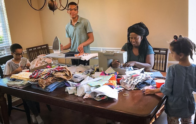 Young people across the United States who have been engaged in Bahá'í community-building efforts swiftly responded to a host of needs arising in their communities. Seen here, a family in Rockwall, Texas, prepared masks for their neighbors.