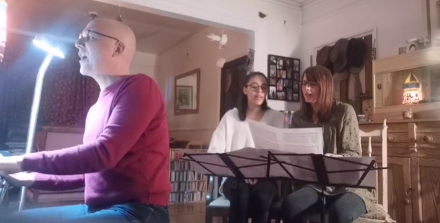 A family in the United Kingdom performs a selection of live music on the theme of humanity's essential oneness. Many such broadcasts have been made throughout the world from living rooms to stimulate reflection on profound spiritual principles.
