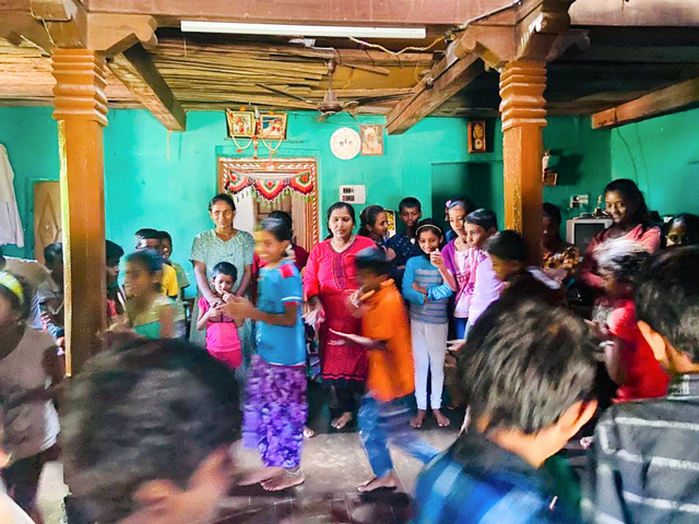Photograph taken before the current global health crisis. Children and parents in Bookanakere, India, participating in a festival prepared by participants of Baha'i educational programs in the village.