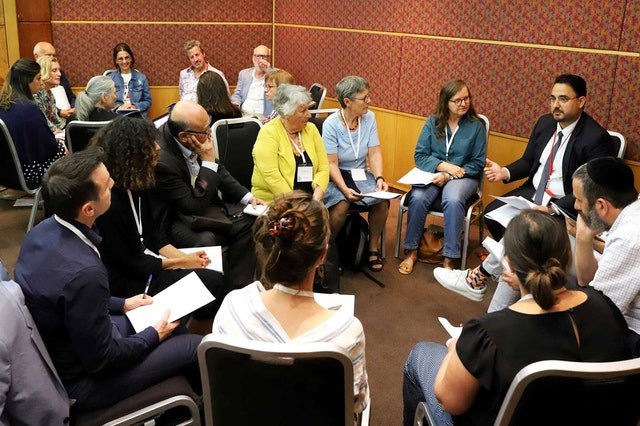 Photograph taken before the current global health crisis. The Australian Baha'i community holds periodic roundtables, such as the one featured here, with diverse social actors, academics, and faith communities to advance conversations on social cohesion.