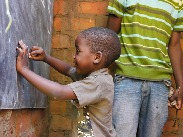 """Photograph taken before the current health crisis. A child studying at a community school in Malawi. """"Since it is the parents of the community who have chosen the individuals who serve as teachers of their children, trust has existed between them from the beginning,"""" says Andrew Nhlane, national coordinator of community schools with the Bambino Foundation."""