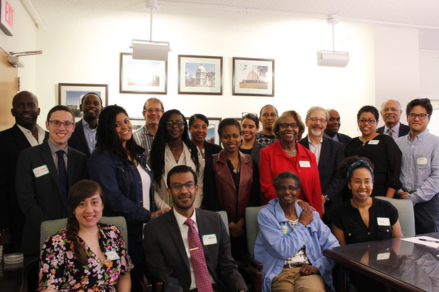 Photograph taken before the current health crisis. Participants at the Dialogue on Faith and Race gathering held by the Baha'i Office of Public Affairs in the United States.