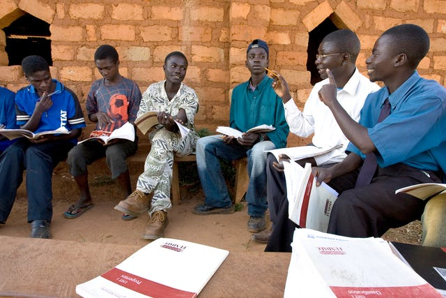 "Photograph taken before the current health crisis. Several Baha'i-inspired organizations in Africa have carried out initiatives enabling rural communities to participate in generating knowledge about agricultural systems. ""When efforts to contribute to social progress draw on both science and insights from religion, opportunities and approaches emerge that would otherwise not be visible,"" says Rachel Bayani."