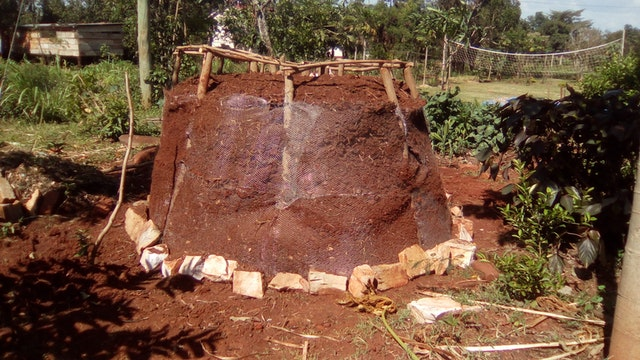 """Construction of a """"food tower"""" at the training center of the Kimanya-Ngeyo Foundation for Science and Education, a Baha'i-inspired organization in Uganda."""