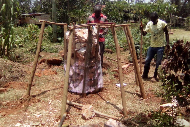 "Construction of a ""food tower"" at the training center of the Kimanya-Ngeyo Foundation for Science and Education, a Baha'i-inspired organization in Uganda."