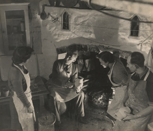 Bernard Leach with his son, David and students in the Old Pottery in St. Ives, England. From the Bernard Leach archive at the Crafts Study Centre, University for the Creative Arts, BHL/8999A.