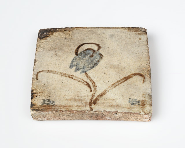 A tile by Bernard Leach, c.1928 on show in the Kai Althoff Goes with Bernard Leach exhibition at the Whitechapel Gallery, London. From the Bernard Leach archive at the Crafts Study Centre, University for the Creative Arts.