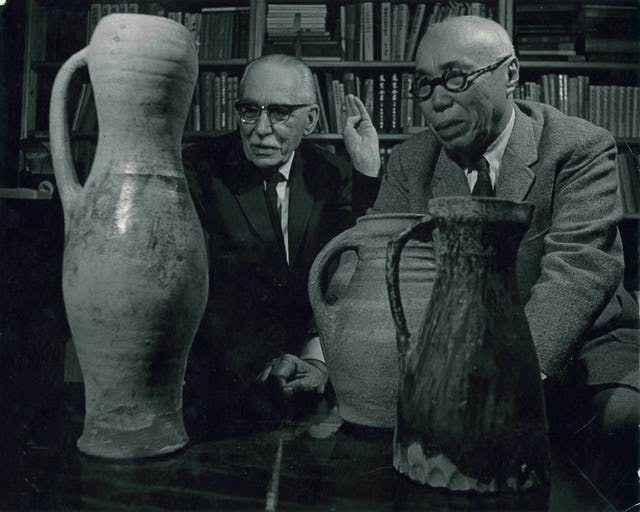 Bernard Leach and Shoji Hamada admiring an English medieval pitcher, 1966. From the Bernard Leach archive at the Crafts Study Centre, University for the Creative Arts, BHL/12872.