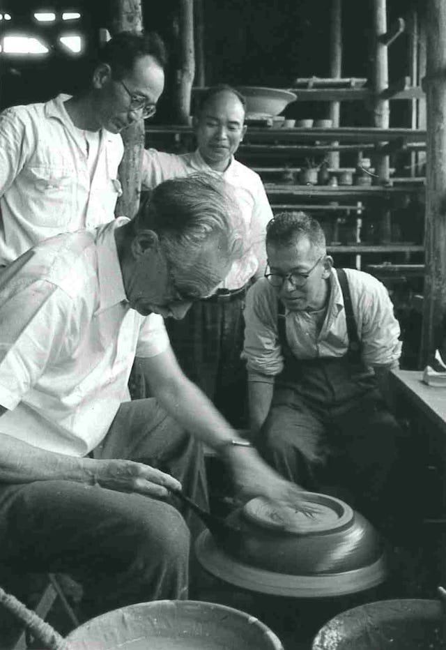 Bernard Leach teaching Japanese students at the Marusan kiln, Fujima. From the Bernard Leach archive at the Crafts Study Centre, University for the Creative Arts, BHL/12677.