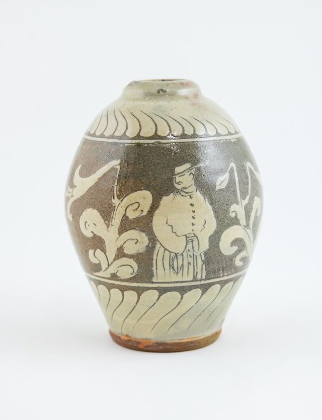 A vase by Bernard Leach, titled 'Solomon among the Lilies', on show in the Kai Althoff Goes with Bernard Leach exhibition at the Whitechapel Art Gallery, London. Image courtesy of Leicester Museums © Bernard Leach Estate.