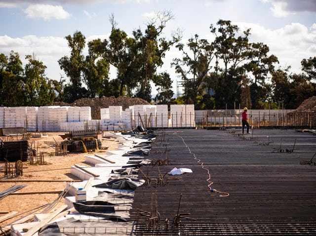 """Once """"void former"""" blocks are put in place, reinforcement bars are laid for the concrete pour."""