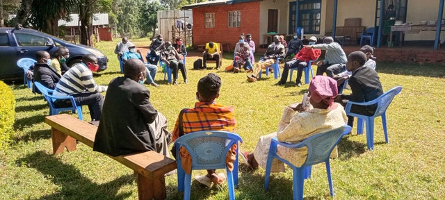 Members of the community discussing the future of the temple. The local House of Worship will be a center of community life in Matunda Soy, inspiring acts of worship and service throughout the area.