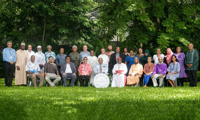 "In-person gatherings were held according to safety measures required by the government. Since the event, government mandates now require the wearing of masks. The interfaith gathering marked World Religion Day and was a joint effort among many faith communities in the country. Imam Busaeri Ismaeel Adekunle (back row, 2nd from left), head of the Islamic Society of Papua New Guinea, says ""As everyone expressed that day, this was a unique occasion and a first in our country."" (Credit: Roan Paul)"