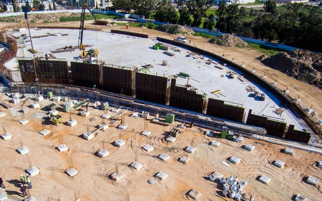 The structural reinforcement and formwork for one of the walls enclosing the south plaza are being assembled.
