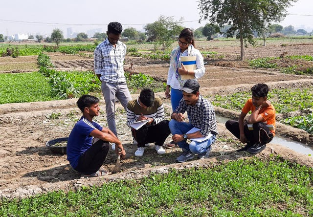 Photograph taken before the current health crisis. The Bahá'í community of India has been involved for years in efforts to develop local agriculture as a means for addressing social and economic challenges. Seen here, participants of the Bahá'í-inspired Preparation for Social Action Program in India study techniques for local agriculture.
