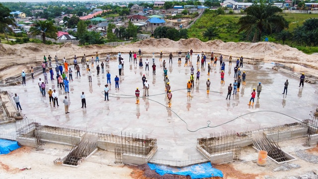 The staff who have been working on the construction of the temple gathered Thursday on the newly completed floor slab to mark this key milestone in the project.