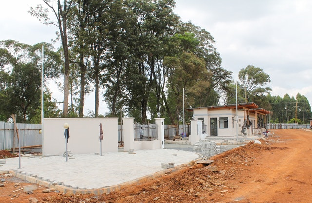 The main gate to the temple grounds nears completion.