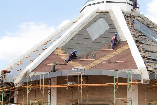 Skylights have been installed on all nine sides of the roof of the temple, and roof tiles are being placed, creating a diamond motif familiar to Kenyan culture.