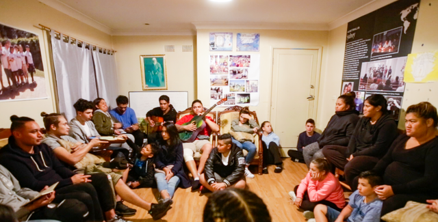 Photograph taken before the current health crisis. The article highlights the vibrant community life that is taking shape in Mount Druitt through gatherings for prayer, discussion, and music.