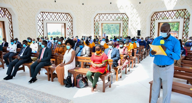 A prayer is read inside the House of Worship during the dedication ceremony.