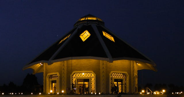A night view of the local Bahá'í House of Worship in Matunda Soy, Kenya. The House of Worship has a unique reality. It stands at the heart of the community, is open to all peoples, and is a place where prayer and contemplation inspire service to society.