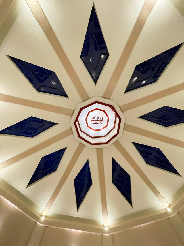 """A sacred Bahá'í symbol known as the Greatest Name has been placed at the apex of the dome. The Greatest Name is a calligraphic representation of the invocation """"O Glory of the All-Glorious."""""""