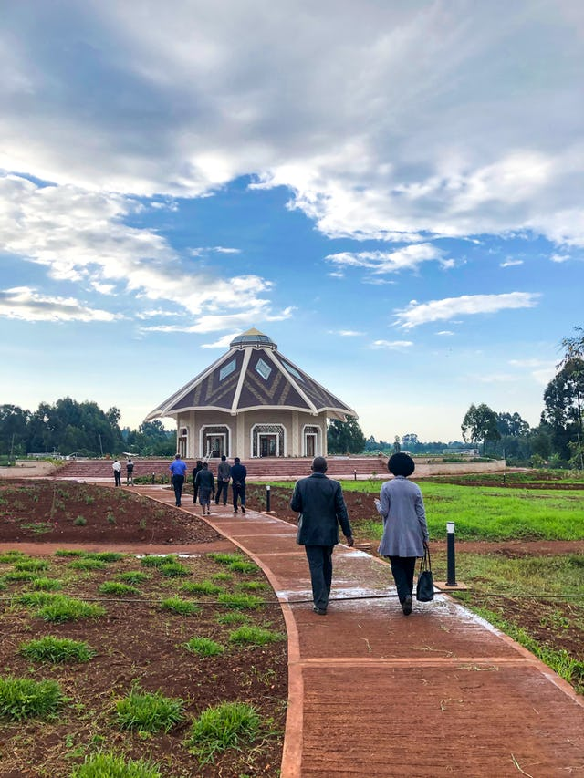Attendees of the opening ceremony approaching the House of Worship in Matunda Soy, Kenya