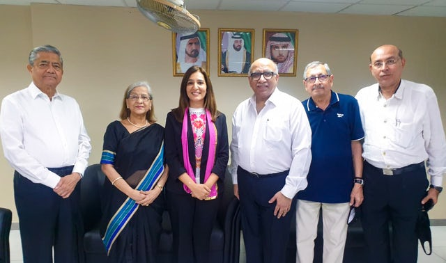 In-person gathering held according to safety measures required by the government. Representatives of the Bahá'í community of the United Arab Emirates meet with leaders of other religious communities in an interfaith gathering hosted by the Hindu community in November 2020.