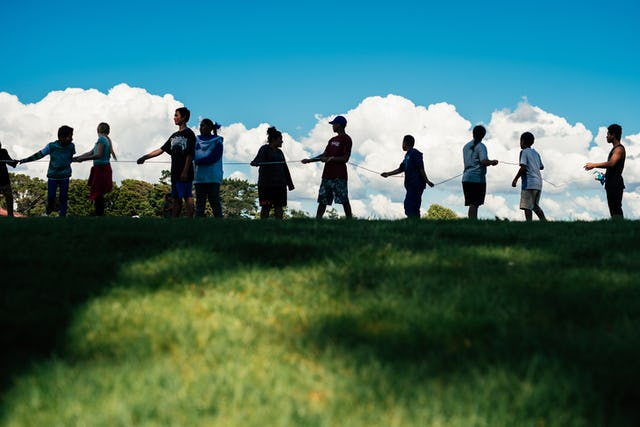 Photographs taken before the current health crisis. Participants in educational initiatives offered by the Bahá'ís of Manurewa learning about unity and co-operation through a group activity.