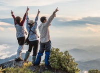Three students on top of a mountain