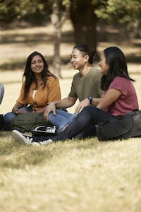 students sitting in park