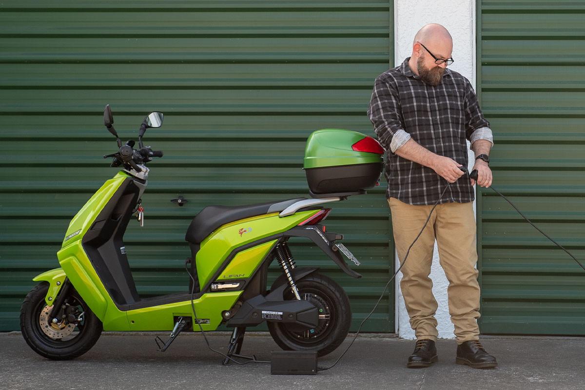 Robert plugs in his electric scooter