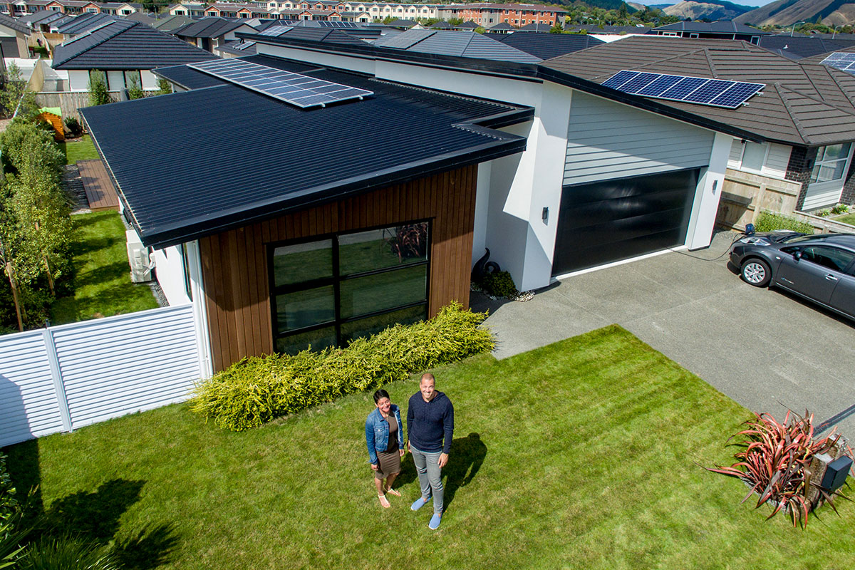 Timo and Valerie Reitnauer stand in front of their solarZero powered home