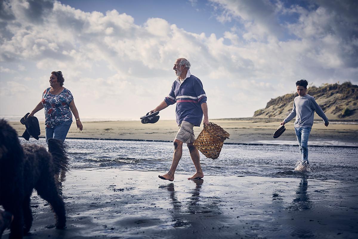 Group walk along beach - keeping a safe distance.