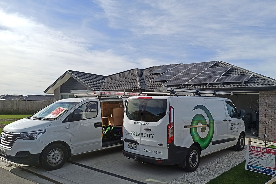 solarcity installing panels and battery at a customer's home.
