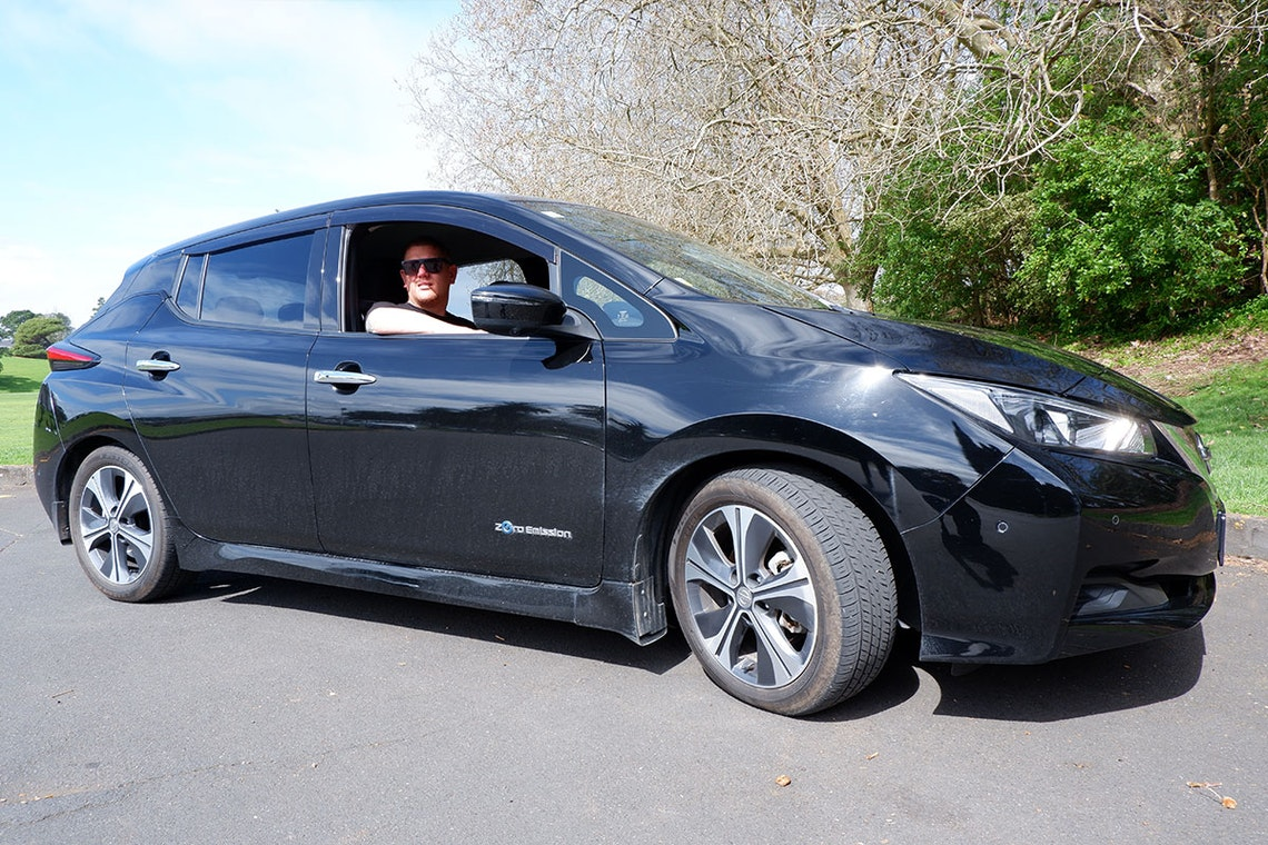 Kahn Denton, relaxed behind the wheel of the solarZero EV