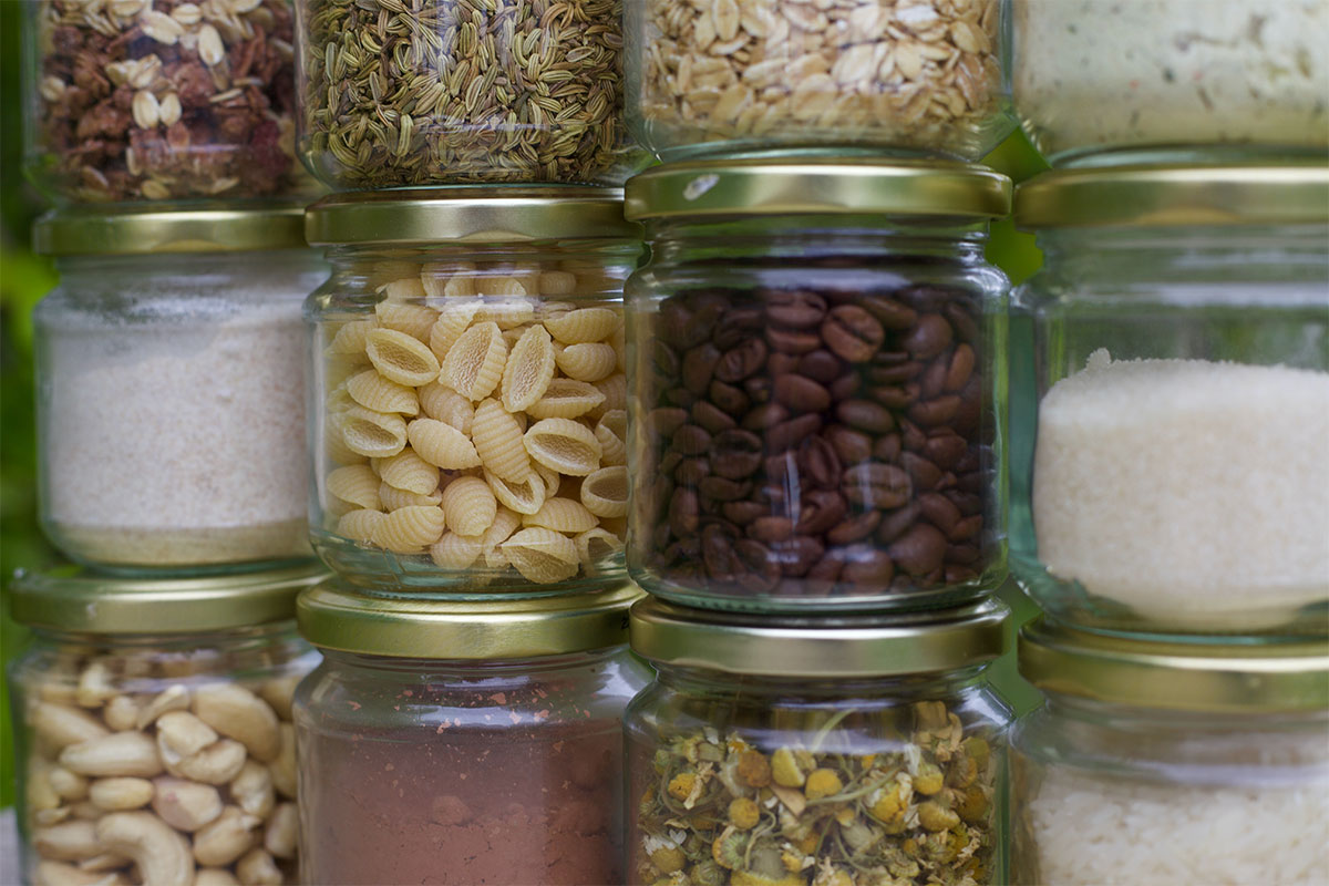 Jars full of pantry staples like pasta, nuts, grains and coffee