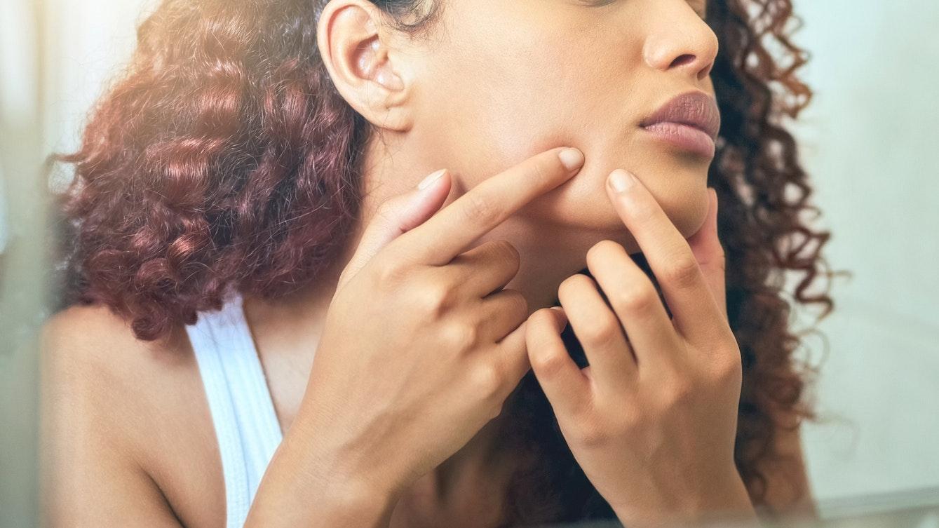 Woman picking her skin