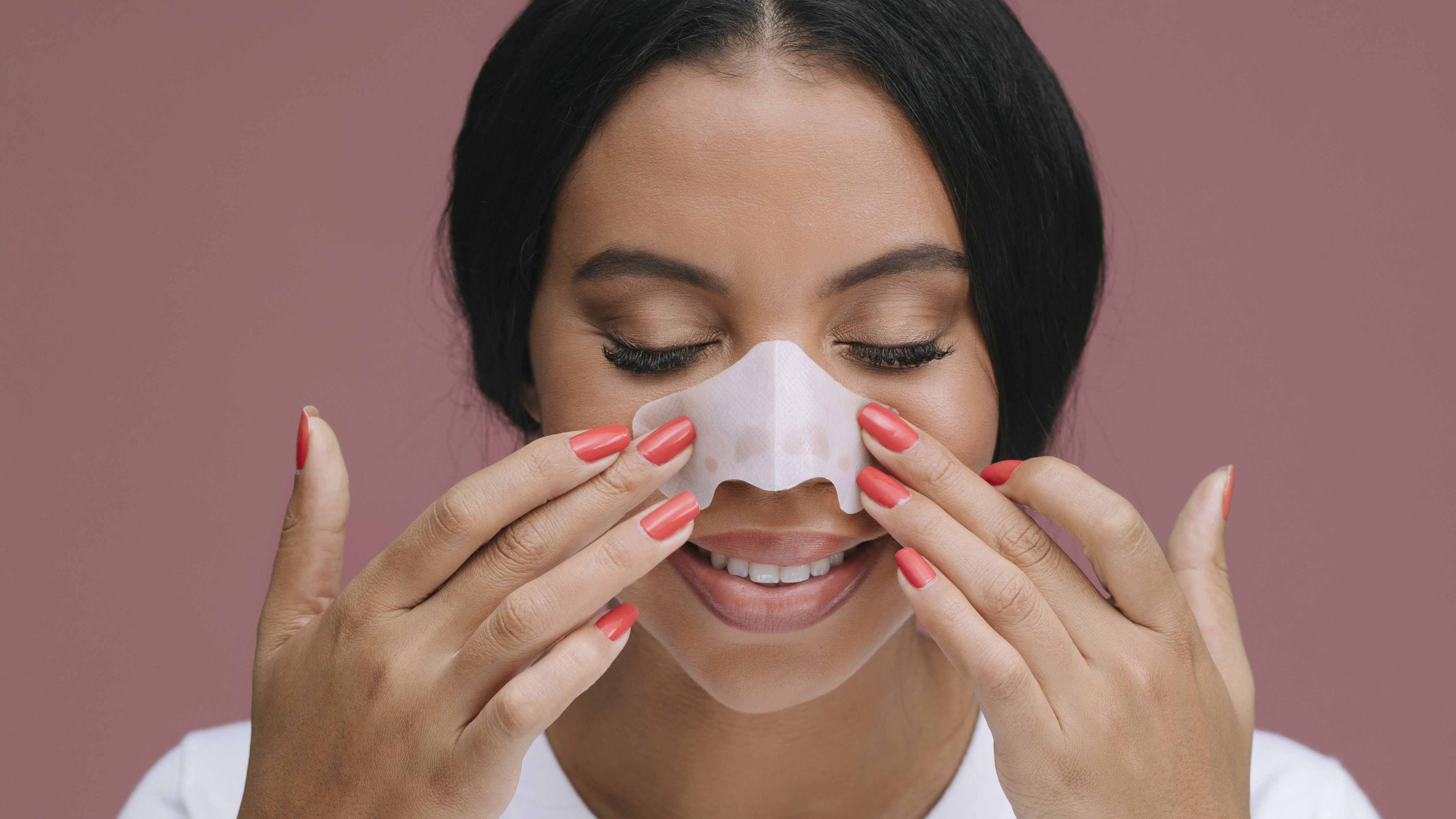 young lady applying nose strip