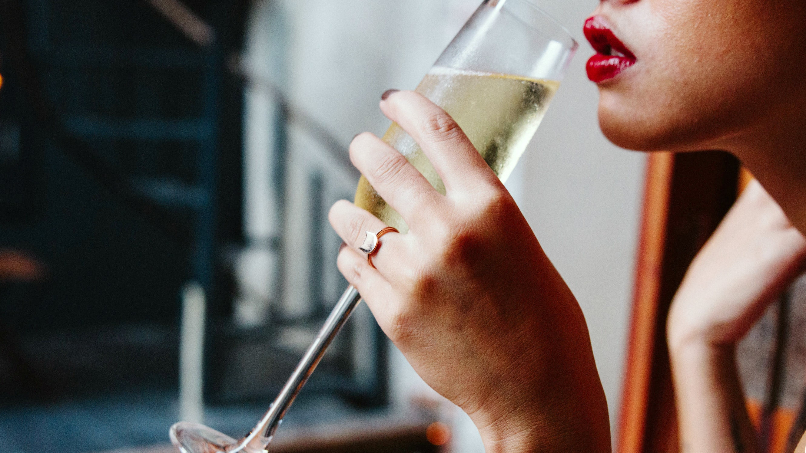 woman sipping champagne