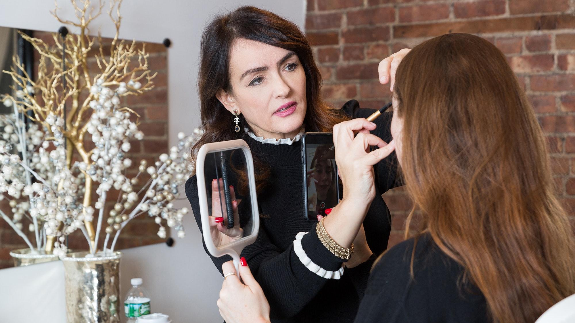 Sania Vucetaj looks in a mirror.