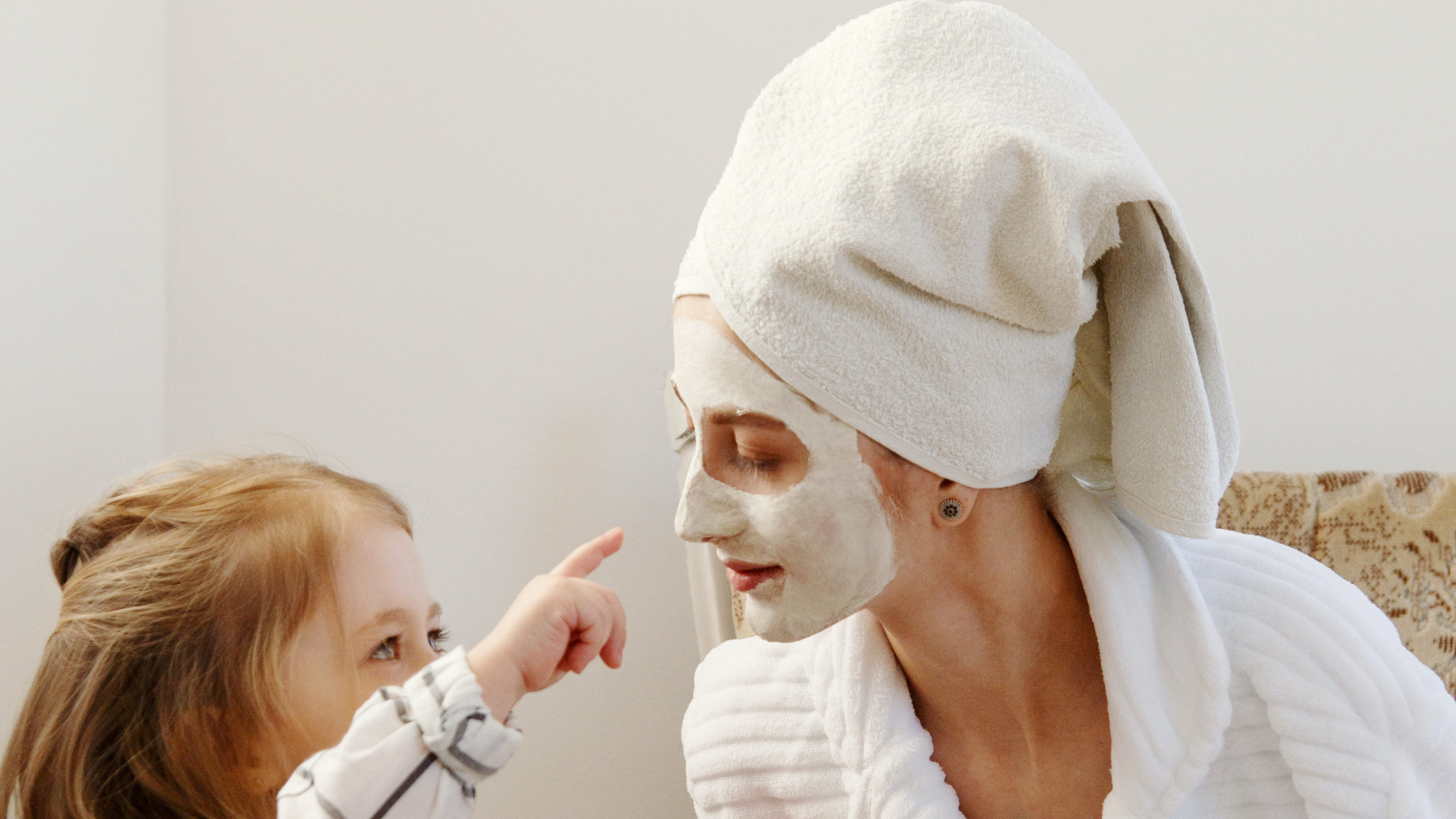 Mother and daughter doing skincare together